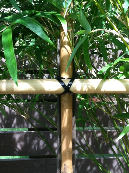 The horizontal poles where attached with zip ties in a criss-cross lashing fashion.